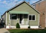 Foreclosed Home en N 34TH AVE, Stone Park, IL - 60165