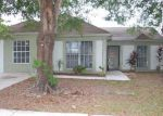 Foreclosed Home in FAWN GROVE PL, Tampa, FL - 33637