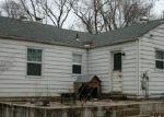Foreclosed Home en NE 52ND ST, Kansas City, MO - 64118