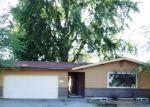 Foreclosed Home en N BIRCH PL, Spokane, WA - 99205