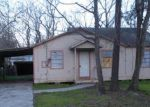 Foreclosed Home in COLUMBINE LN, Houston, TX - 77049