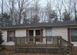 Foreclosed Home en W BEECH ST, Ludington, MI - 49431