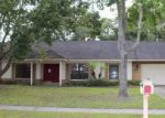 Foreclosed Home en WOODBROOK DR, Tampa, FL - 33625