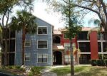Foreclosed Home en KEY ROYALE LN, Tampa, FL - 33614