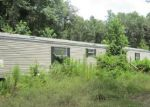 Foreclosed Home in FIR PL, New Caney, TX - 77357