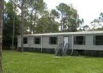 Foreclosed Home en BOGART DR, North Fort Myers, FL - 33917