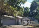 Foreclosed Home en SWEETWATER DR, Lake Ozark, MO - 65049