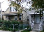 Foreclosed Home en N KARLOV AVE, Chicago, IL - 60639