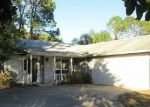 Foreclosed Home en PHEASANT DR, Palm Coast, FL - 32164