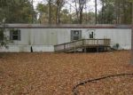 Foreclosed Home in KILLER BEE LN, New Caney, TX - 77357