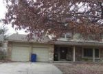 Foreclosed Home en ROCK FENCE PL, Lawrence, KS - 66049