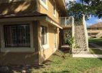 Foreclosed Home en NW 214TH ST, Miami, FL - 33169