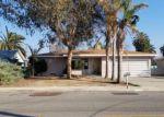 Foreclosed Home en PATTON ST, Delano, CA - 93215