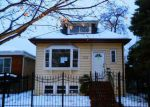 Foreclosed Home en N MELVINA AVE, Chicago, IL - 60639