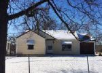 Foreclosed Home in S BENTON AVE, Kansas City, MO - 64130
