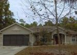 Foreclosed Home en KADASHOW AVE, North Port, FL - 34288