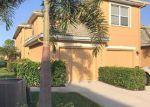 Foreclosed Home en DONNAVID CT, Bonita Springs, FL - 34135