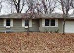 Foreclosed Home en E 133RD TER, Grandview, MO - 64030