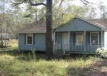 Foreclosed Home in COUNTRY ESTATES DR, New Caney, TX - 77357