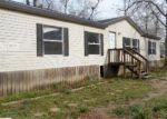 Foreclosed Home en MAHAN LN, Huffman, TX - 77336