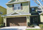 Foreclosed Home en WEEPING LAUREL PL, Tampa, FL - 33647