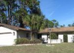 Foreclosed Home en BEECHWOOD LN, Palm Coast, FL - 32137