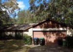 Foreclosed Home en PINE OAKS CT, Apopka, FL - 32712