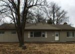 Foreclosed Home en E 54TH TER, Kansas City, MO - 64129