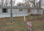Foreclosed Home en EVANS MAIN ST, Oskaloosa, IA - 52577