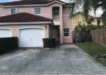 Foreclosed Home en SW 102ND TER, Miami, FL - 33186
