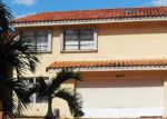Foreclosed Home en NW 201ST TER, Hialeah, FL - 33015