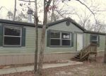 Foreclosed Home en WINDWOOD DR, Livingston, TX - 77351
