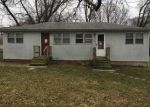 Foreclosed Home en NE 43RD TER, Kansas City, MO - 64117