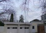 Foreclosed Home en W OLIVER ST, Owosso, MI - 48867
