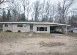 Foreclosed Home en CABERFAE HWY, Manistee, MI - 49660