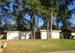 Foreclosed Home in CHALLE CIR E, Spring, TX - 77373
