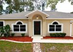 Foreclosed Home en PEPPERDINE DR, Palm Coast, FL - 32164