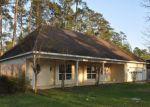 Foreclosed Home en RIVERWOOD DR, Magnolia, TX - 77354