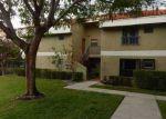 Foreclosed Home en NW 49TH TER, Pompano Beach, FL - 33063