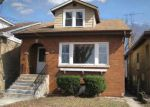 Foreclosed Home en N OZANAM AVE, Harwood Heights, IL - 60706