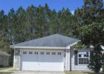 Foreclosed Home en COMMODORE POINT DR, Yulee, FL - 32097