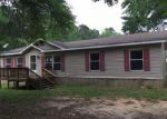 Foreclosed Home en MARTIN CREEK DR, Cleveland, TX - 77328