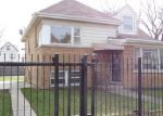 Foreclosed Home en N MANGO AVE, Chicago, IL - 60639