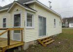 Foreclosed Home en CEDAR ST, Honor, MI - 49640