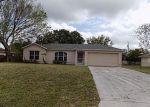 Foreclosed Home en SW ESTATE AVE, Port Saint Lucie, FL - 34953