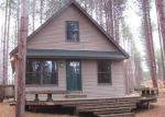 Foreclosed Home en MARVIS RD, Honor, MI - 49640