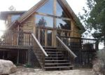 Foreclosed Home en WHISPERING PINES RD, Tijeras, NM - 87059