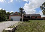 Foreclosed Home en SW COLEMAN AVE, Port Saint Lucie, FL - 34953