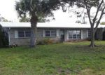 Foreclosed Home en SW FEROE AVE, Palm City, FL - 34990