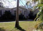Foreclosed Home en SW 83RD ST, Palm City, FL - 34990